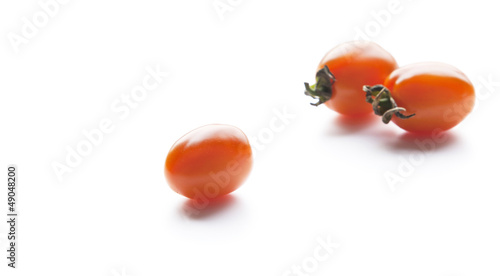 Tomato on a white background.