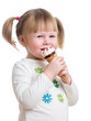 cute little girl eating ice cream in studio isolated