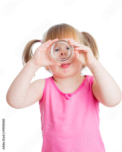 kid girl drinking water from glass over white background