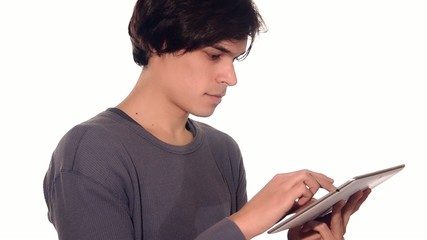 young man working on his tablet computer