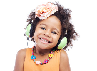 Joyful little girl in big headphones