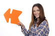woman holding orange arrow