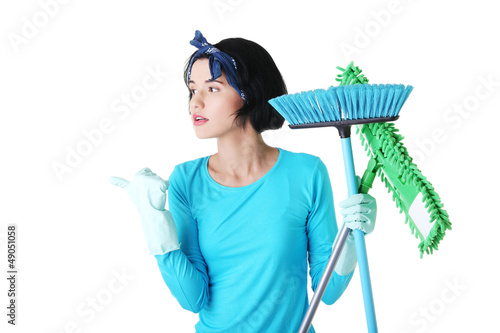 Happy cleaning woman showing copy space.