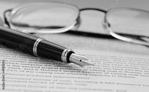 Pen and glasses on documents