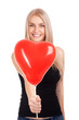 Young woman with heart shape balloon
