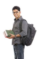 Indian young student carrying books on white.