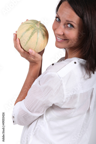 Woman holding melon