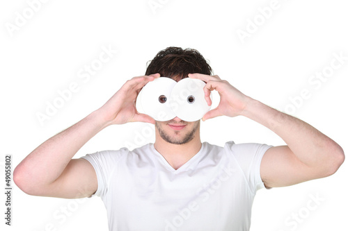 young man hiding his face behind a mask