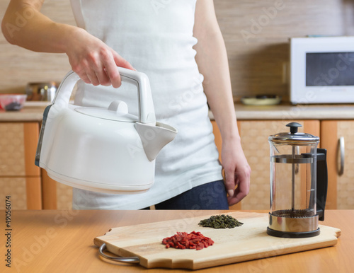 woman preparing tea