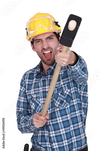 An angry construction worker with a sledgehammer.