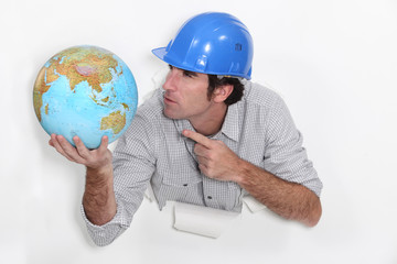 Builder angrily pointing at globe