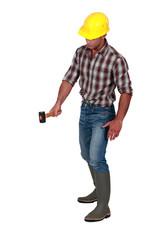 Worker holding hammer