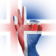 hand OK sign with Icelanic flag