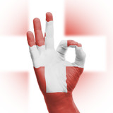hand OK sign with Swiss flag