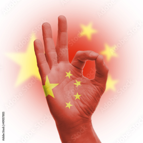 hand OK sign with Chinese flag
