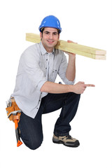 woodworker pointing at something