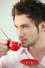 Man with red coffee cup