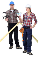 Two woodworker stood with money