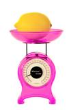 Magenta kitchen scales and lemon