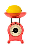 Red kitchen scales and lemon