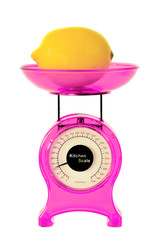 Magenta kitchen scales and lemon