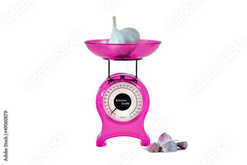 Magenta kitchen scales and garlic