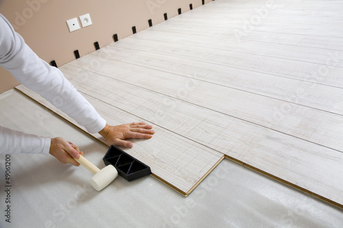 Worker laying laminated