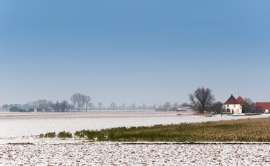 Dutch rural winter landscape with snowy fields