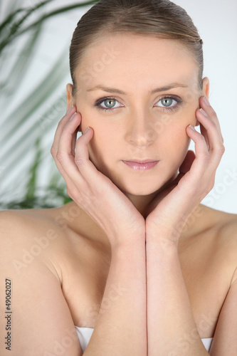 Woman at a spa with her chin in her hands