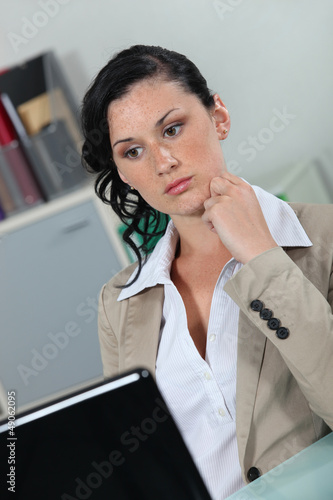 Secretary staring at her laptop
