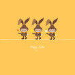 3 Bunnies Holding Spring Flowers Orange