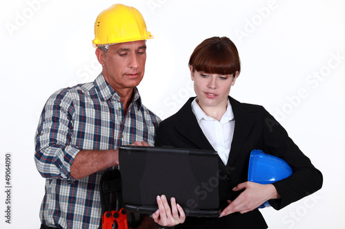 Architect and builder with a laptop