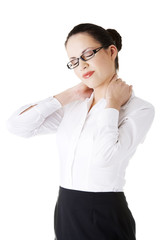 Businesswoman with back ache after long work.