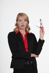 woman in a suit looking surprised