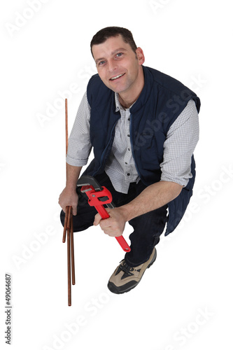 Plumber with a wrench and copper pipe