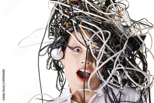 Shocked businesswoman with cables on head