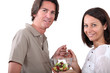 Couple eating fruit salad