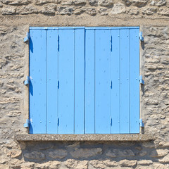Old blue painted wooden window in Provence, France. Pattern