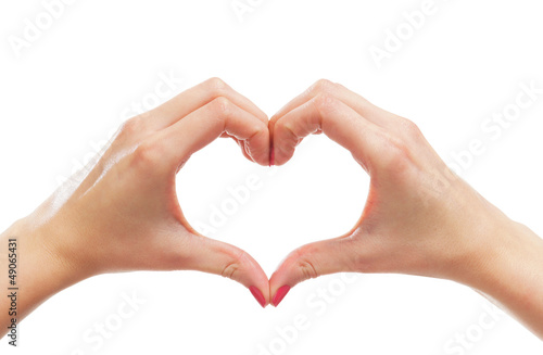 Beautiful female hands in a shape of a heart on white