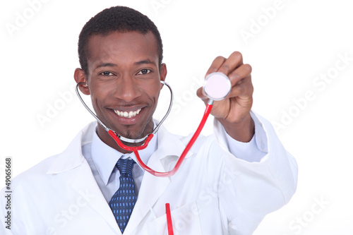 Physician holding up a stethoscope