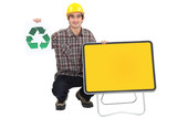 Young manual worker with recycle logo and blank road sign