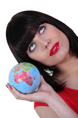Smart woman with globe in hand
