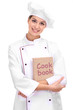 Portrait of young woman chef with cook book isolated on white