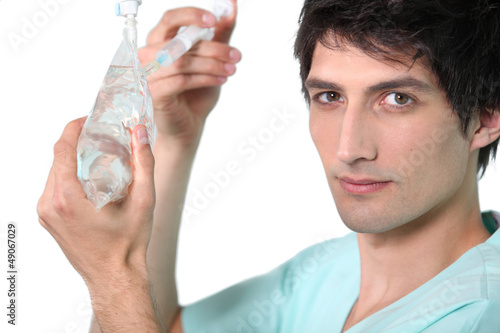 Nurse preparing drip.
