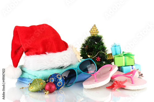 Beach accessories and Christmas tree isolated on white