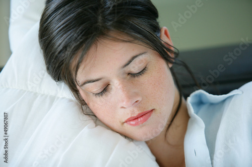 Young woman resting on a sofa