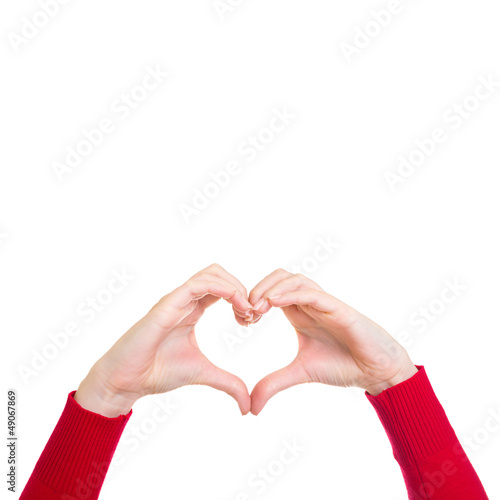 Female hands showing heart sign