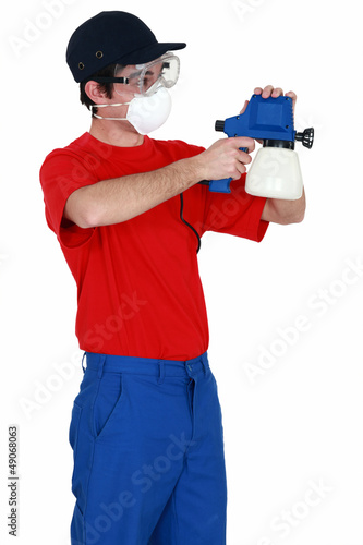 Man holding a paint sprayer
