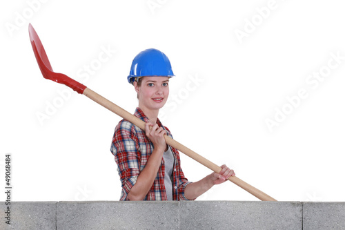 Female mason holding shovel