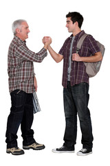 Senior man and young man handshaking